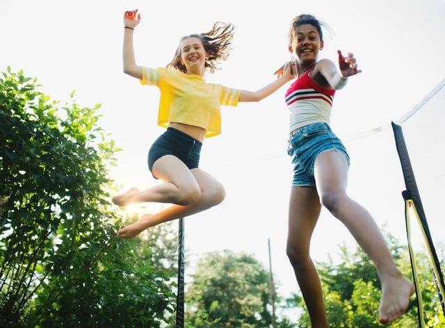 teenage girls on a trampoline