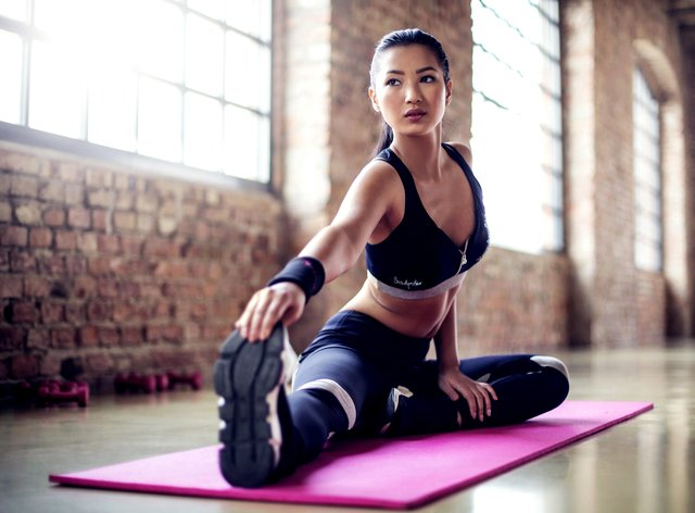 Workout with a conscience - woman stretching