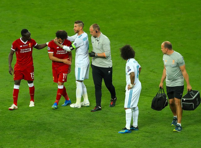 Liverpool's Mohamed Salah is consoled by Real Madrid's Sergio Ramos after his injury in the 2018 Champions League final