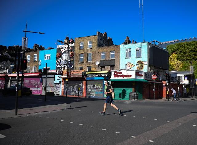 A man jogs down an empty Camden High Street