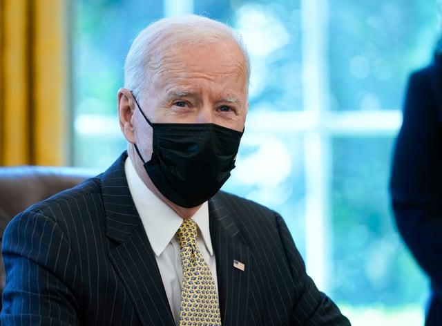 President Joe Biden sitting at a desk