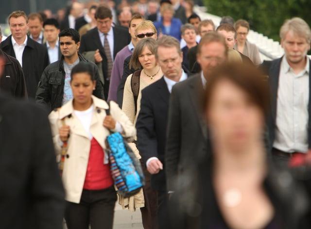 A crowd of people on Waterloo Bridge in central London
