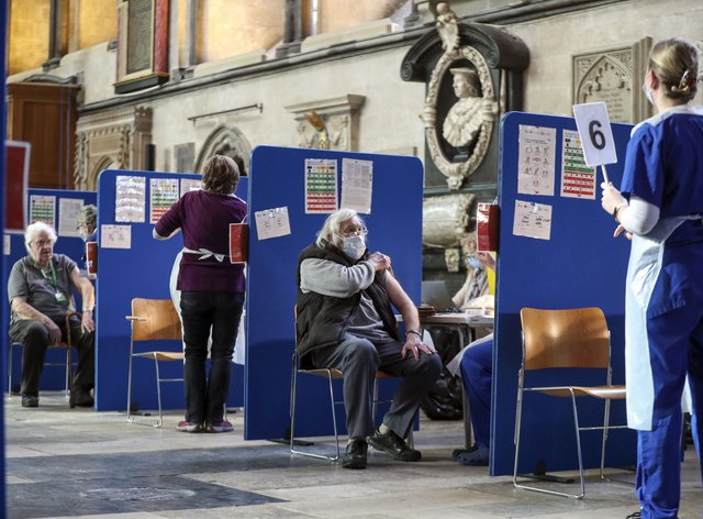 Members of the public receive an injection of the coronavirus vaccine at Salisbury Cathedral, Wiltshire (Steve Parsons/PA)