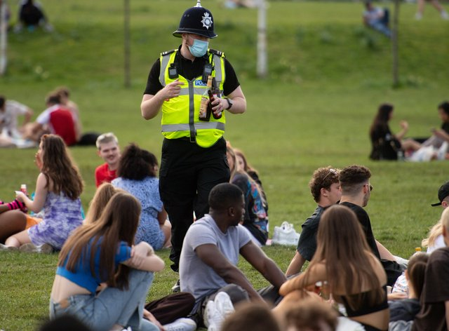 Police officers confiscate alcohol at the Forest Recreation Ground in Nottingham