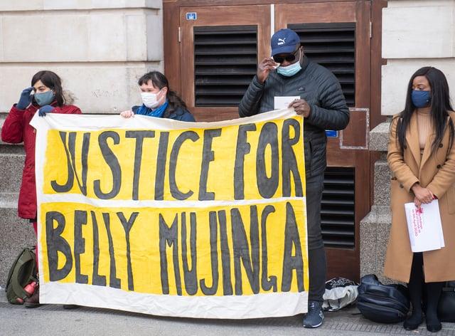 Lusamba Katalay (third from left), the husband of Belly Mujinga, joins activists at a vigil at Victoria station