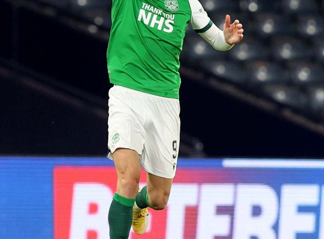 Hibernian's Christian Doidge scores against Queen of the South