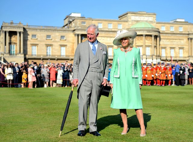 The Prince of Wales and the Duchess of Cornwall during a garden party at Buckingham Palace