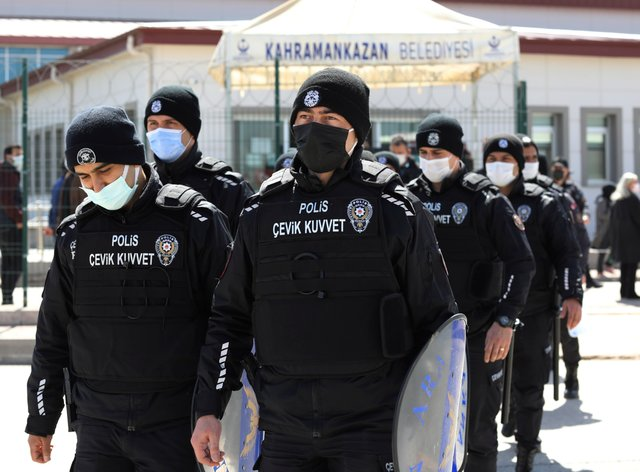 Riot police officers leave a courthouse during the trial of 497 defendants, in Sincan, outside the capital Ankara, Turkey (Burhan Ozbilici/AP)
