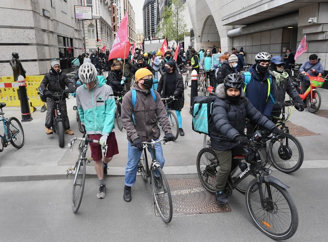 Deliveroo riders from the Independent Workers' Union of Great Britain in the City of London, as they go on strike