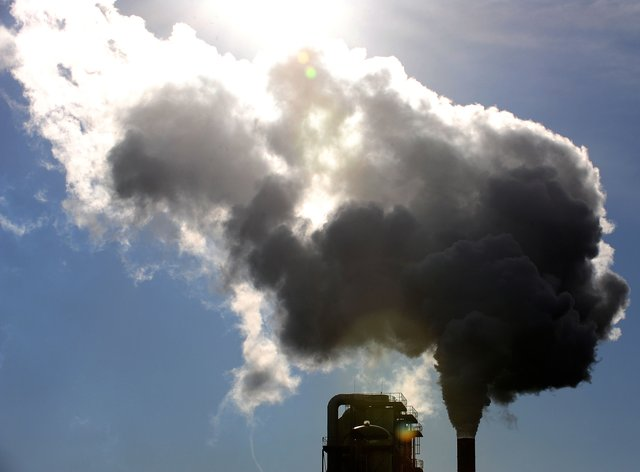 Smoke rises from a woodchip plant