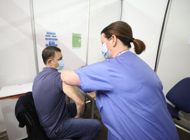 A man receives a Covid-19 vaccination
