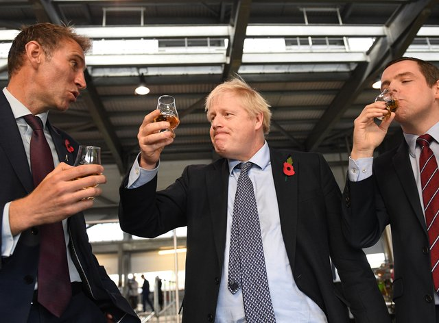 Scottish Tory leader Douglas Ross (right) and Prime Minister Boris Johnson (centre)