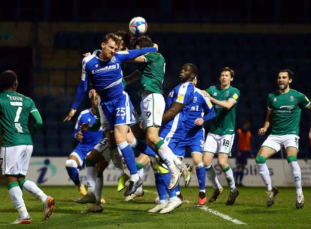 Gillingham's Robbie Cundy, left, is close to a return