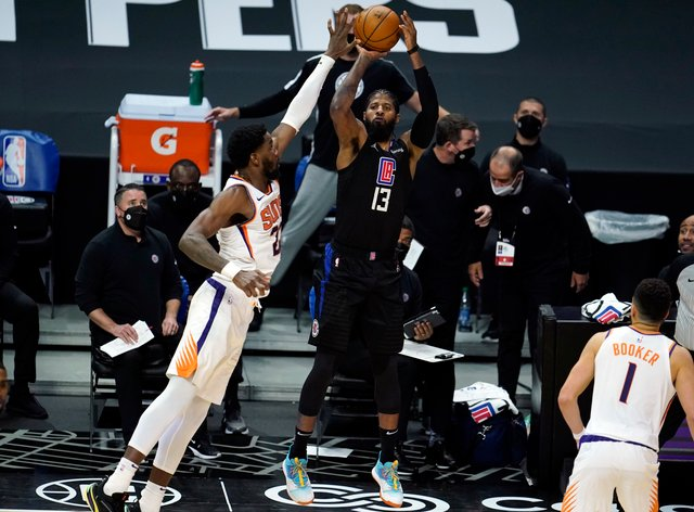 Los Angeles Clippers guard Paul George makes a 3-pointer