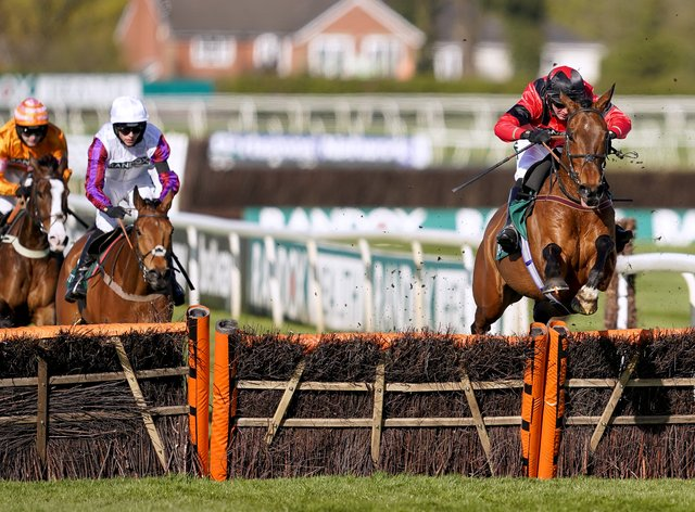 Ahoy Senor ridden by Derek Fox (right) clears a fence on their way to winning the Doom Bar Sefton Novices' Hurdle during Ladies Day of the 2021 Randox Health Grand National Festival