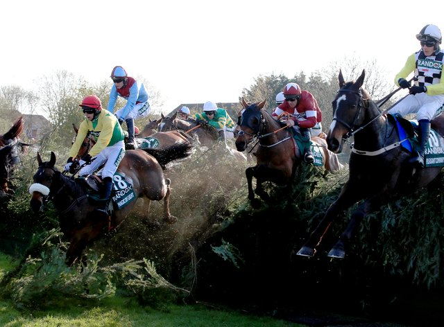 Tiger Roll ridden by jockey Davy Russell (centre) on the way to winning the Randox Health Grand National in 2019