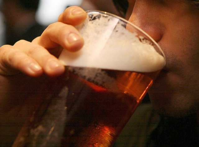 A man drinks a pint
