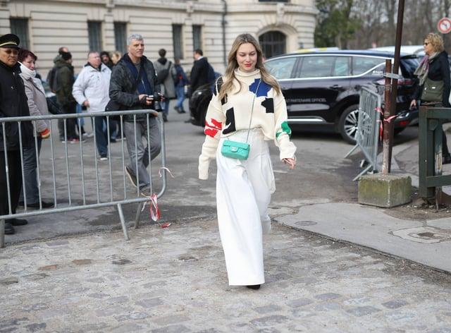 Woman wearing wide legged trousers walking down the street