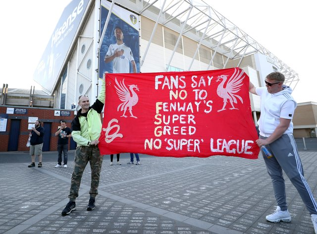 Fans protest outside the Leeds stadium against Liverpool's decision to join a proposed new European Super League ahead of the clubs' Premier League fixture
