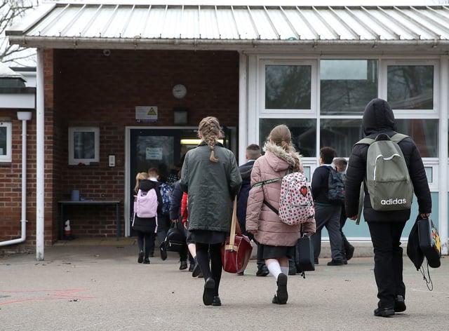 Children walk into school