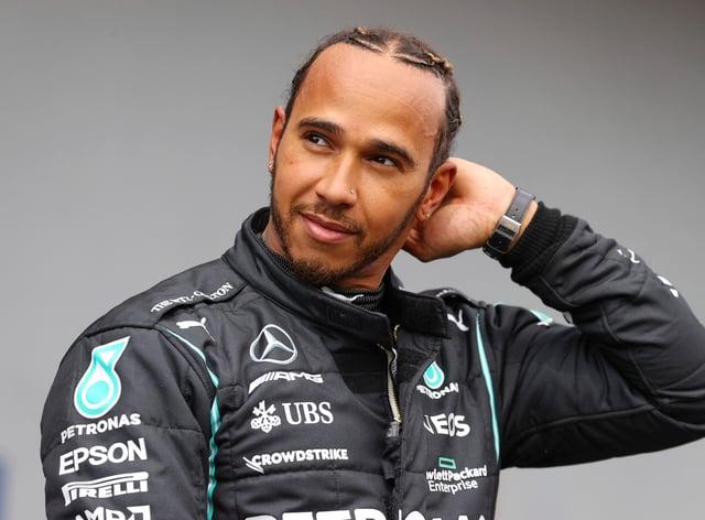 Lewis Hamilton looks on