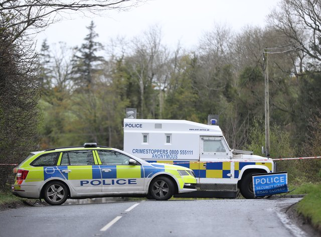 PSNI vehicles blocking a road during the security operation