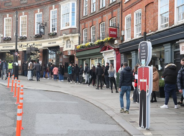 People queue outside the Wetherspoon's King and Castle pub in Windsor