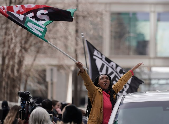 People cheer after a guilty verdict was announced at the trial of former Minneapolis police Officer Derek Chauvin for the death of George Floyd