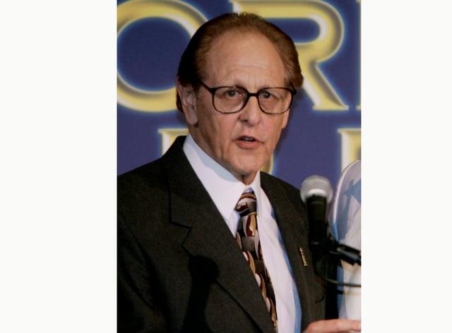 File photo of Philip Berk speaking at a podium