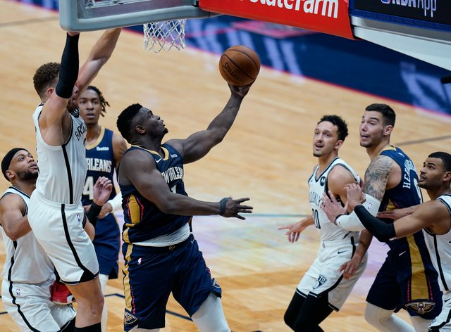 New Orleans Pelicans forward Zion Williamson goes to the basket in the second half of an NBA basketball game against the Brooklyn Nets