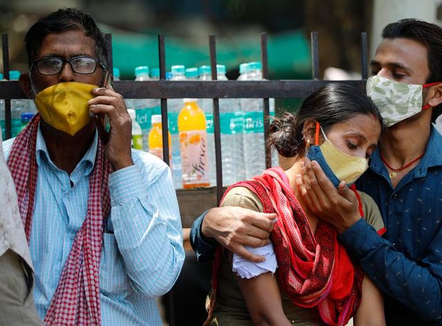 Relatives of a Covid-19 victim outside the Lok Nayak Jaiprakash Narayan Covid-19 hospital in New Delhi, India