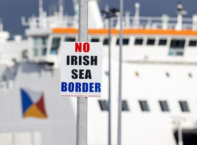 A sign on a lamp post outside Larne Port with the word 'No Irish Sea Border'
