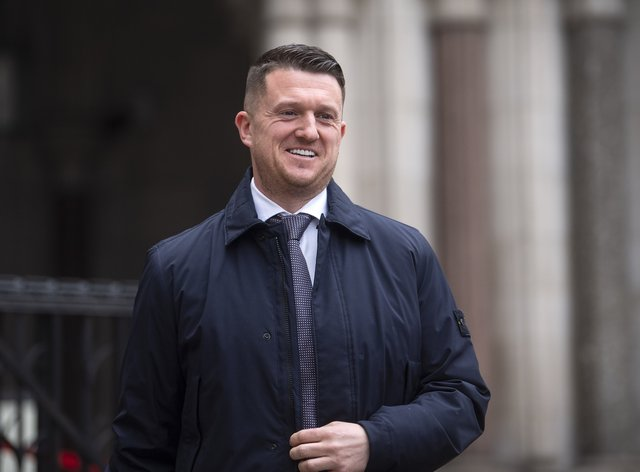 Tommy Robinson leaving the Royal Courts of Justice