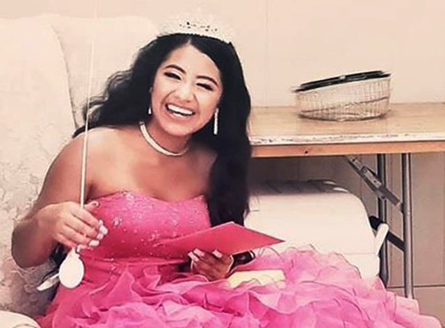 Adriana Palma wears a tiara and ballgown on her quinceanera, her 15th birthday celebration