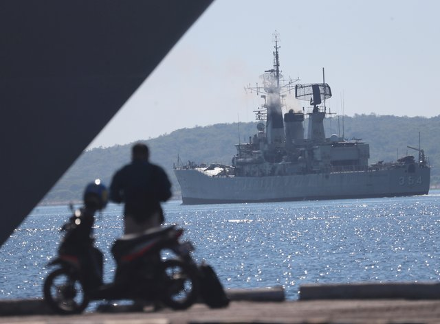 Indonesian navy ship Oswad Siahaan sails to join the search for submarine KRI Nanggala