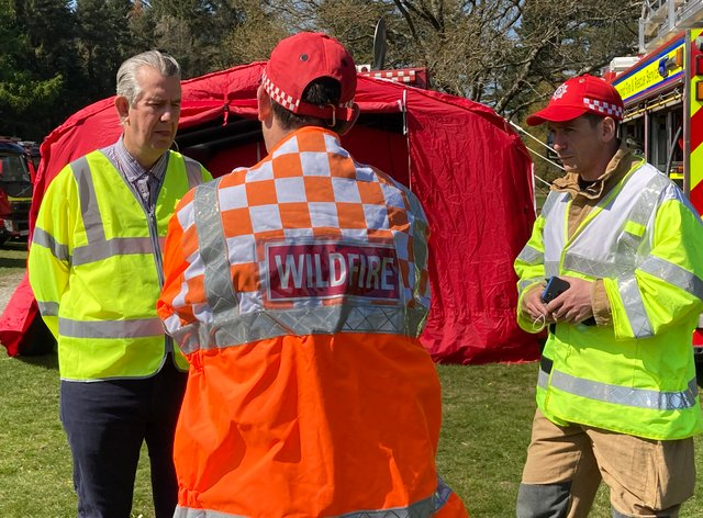Edwin Poots talks to firefighters