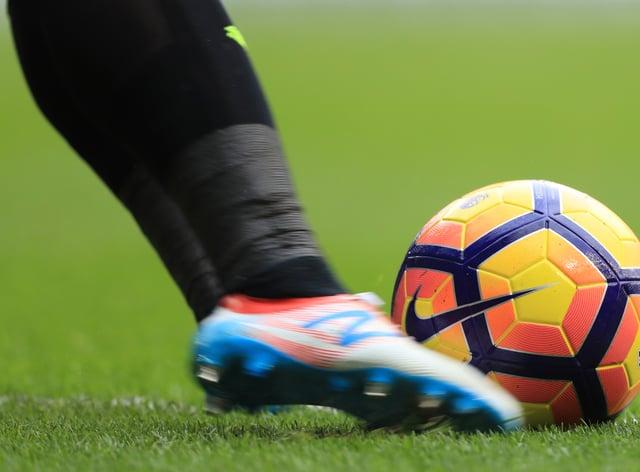 A player kicking a football