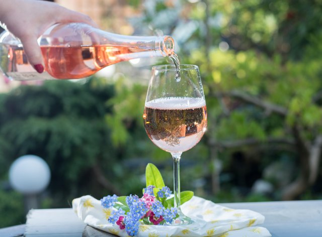 Pouring a glass of rose wine in the sunshine