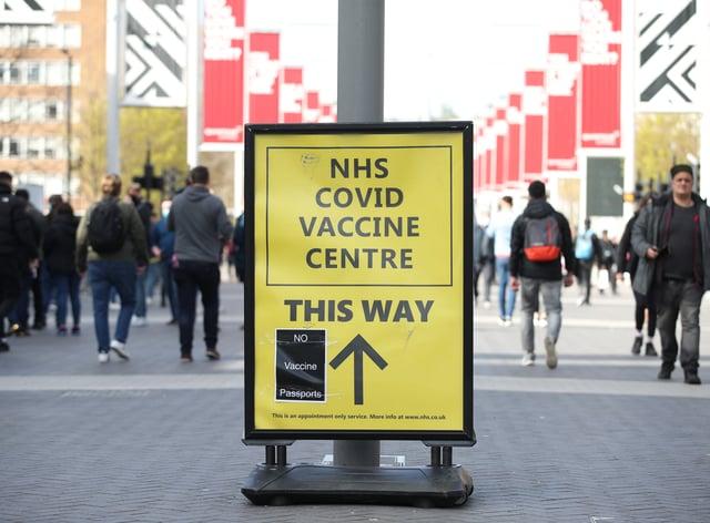 No Vaccine Passports protest sticker on a Vaccine Centre billboard