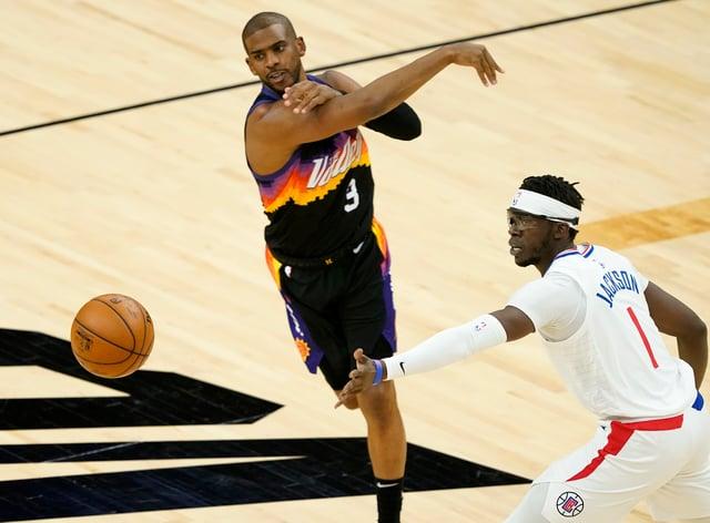 Phoenix Suns guard Chris Paul (centre) and Los Angeles Clippers guard Reggie Jackson