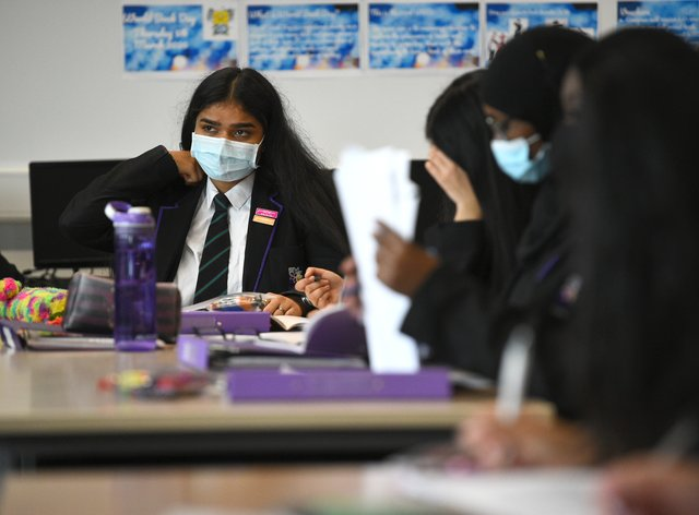 Children wearing facemasks during a lesson at Hounslow Kingsley Academy in West London (Kirsty O'Connor/PA)