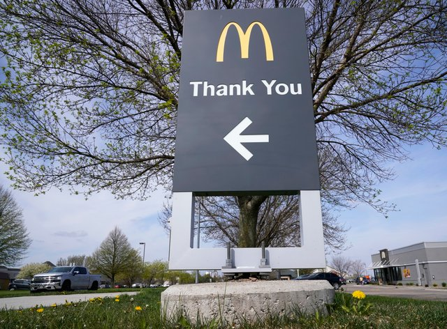 A thank you sign in front of a McDonald's restaurant