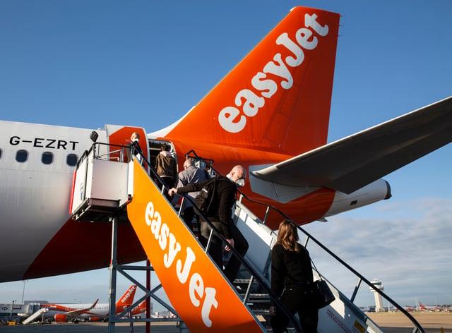Passengers board an easyJet flight