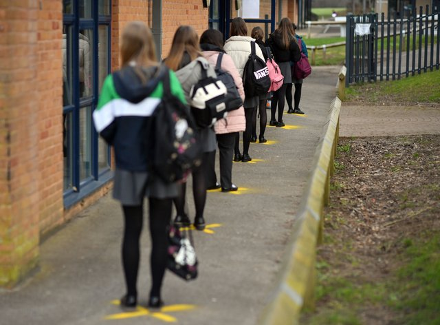 File photo of pupils queuing to take a lateral flow test at Archway School in Stroud in Gloucestershire (Ben Birchall/PA)