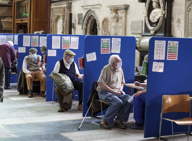 Members of the public receive an injection of the coronavirus vaccine at Salisbury Cathedral, Wiltshire