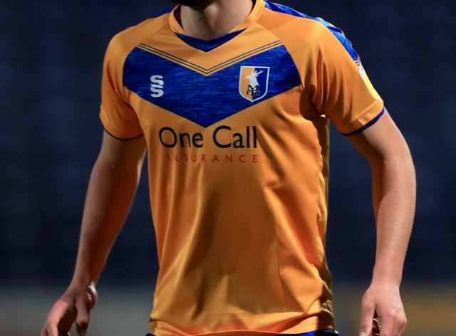 Mansfield will be without Farrend Rawson against Oldham.