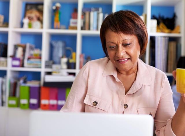 Mature woman looking at computer at home