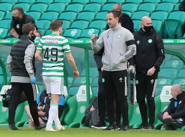 John Kennedy, centre right, greets James Forrest as he is substituted after an injury against Livingston