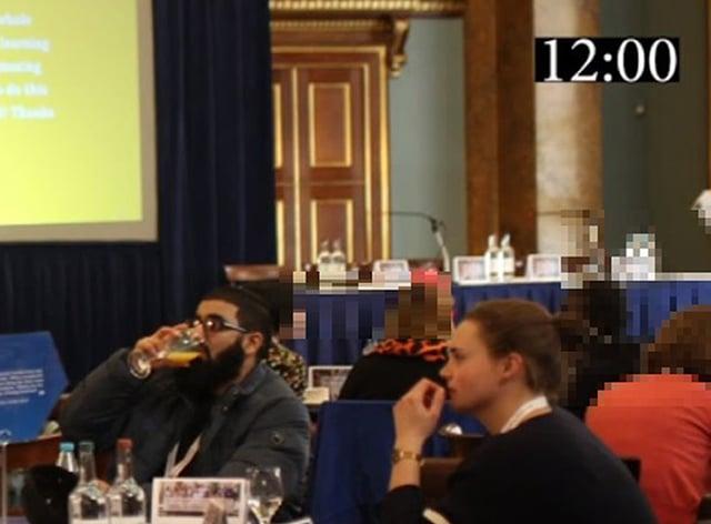 Usman Khan and Saskia Jones sat at a table together at the prisoner rehabilitation event
