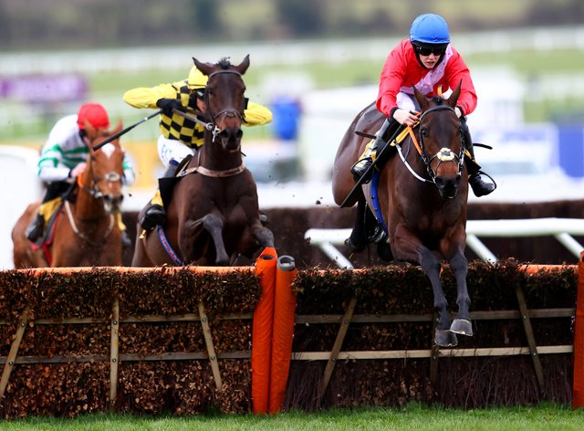 Quilixios (right) on his way to winning the Triumph Hurdle